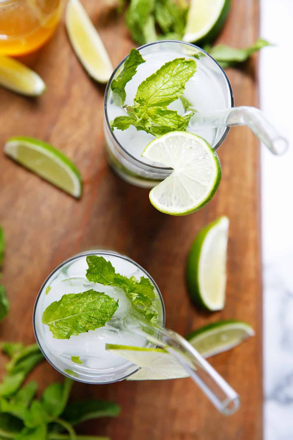 Mojito recipe on a cutting board surrounded by limes
