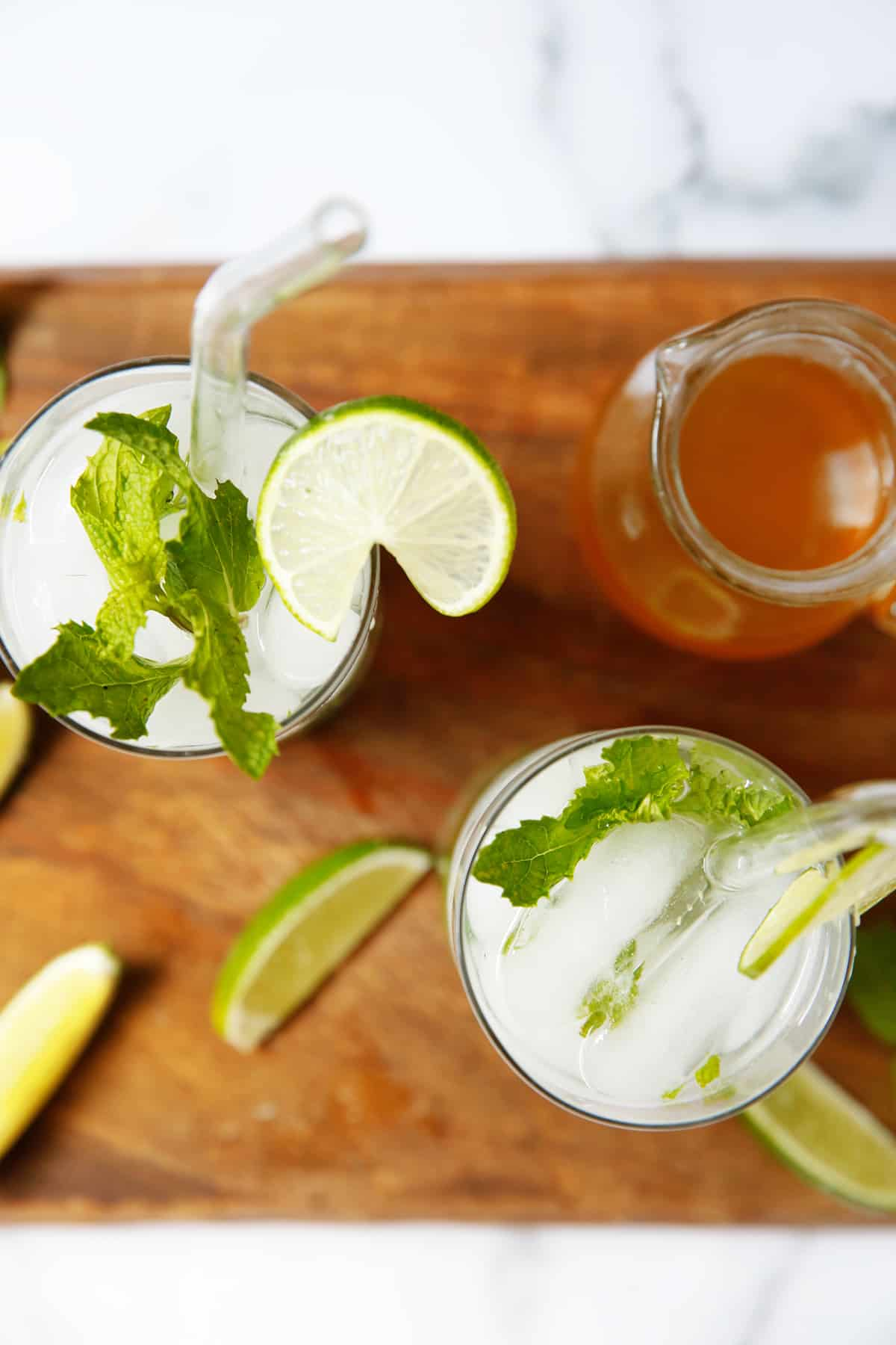 Two mojito cocktails with simple syrup