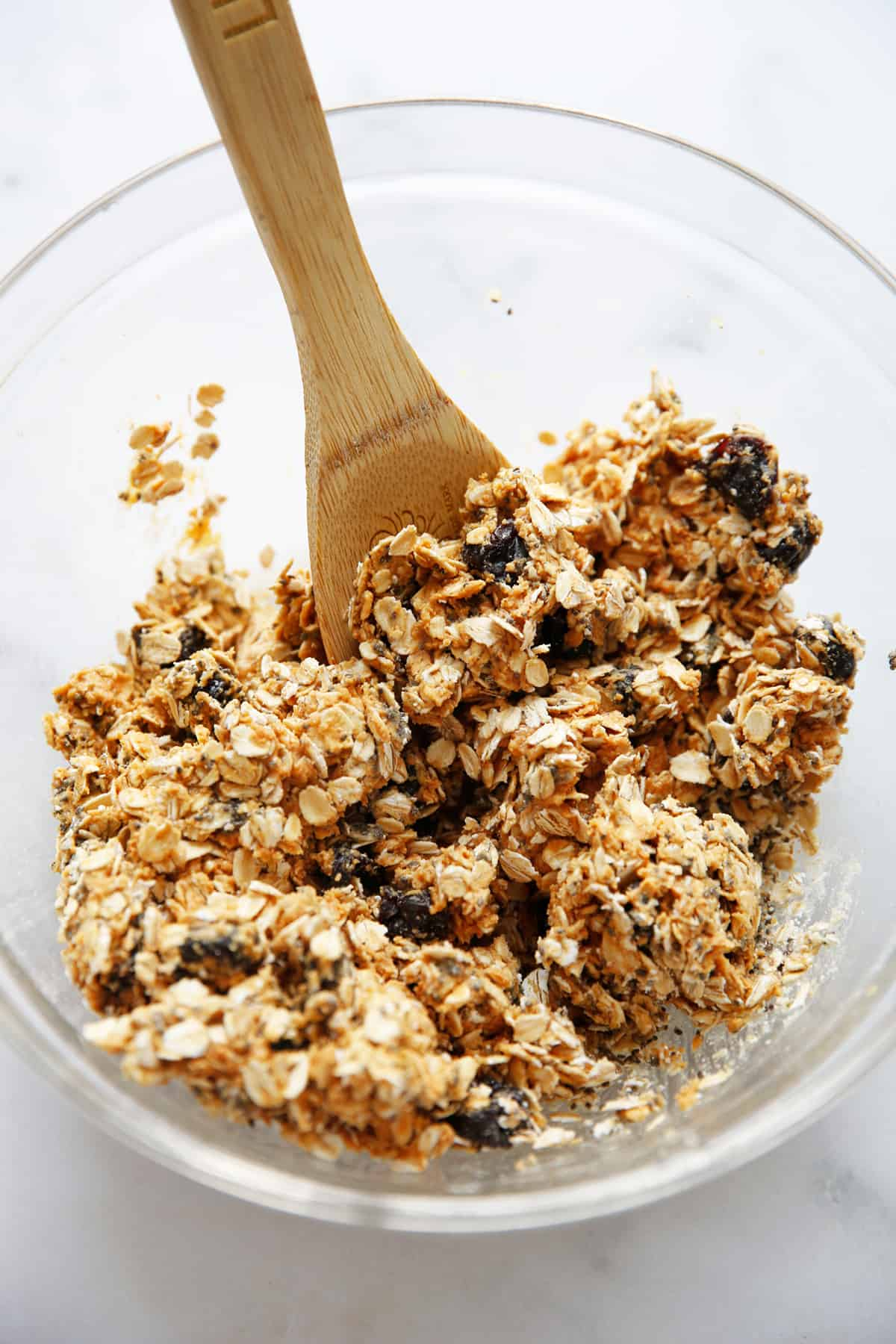 ingredients for peanut butter oatmeal balls in a bowl