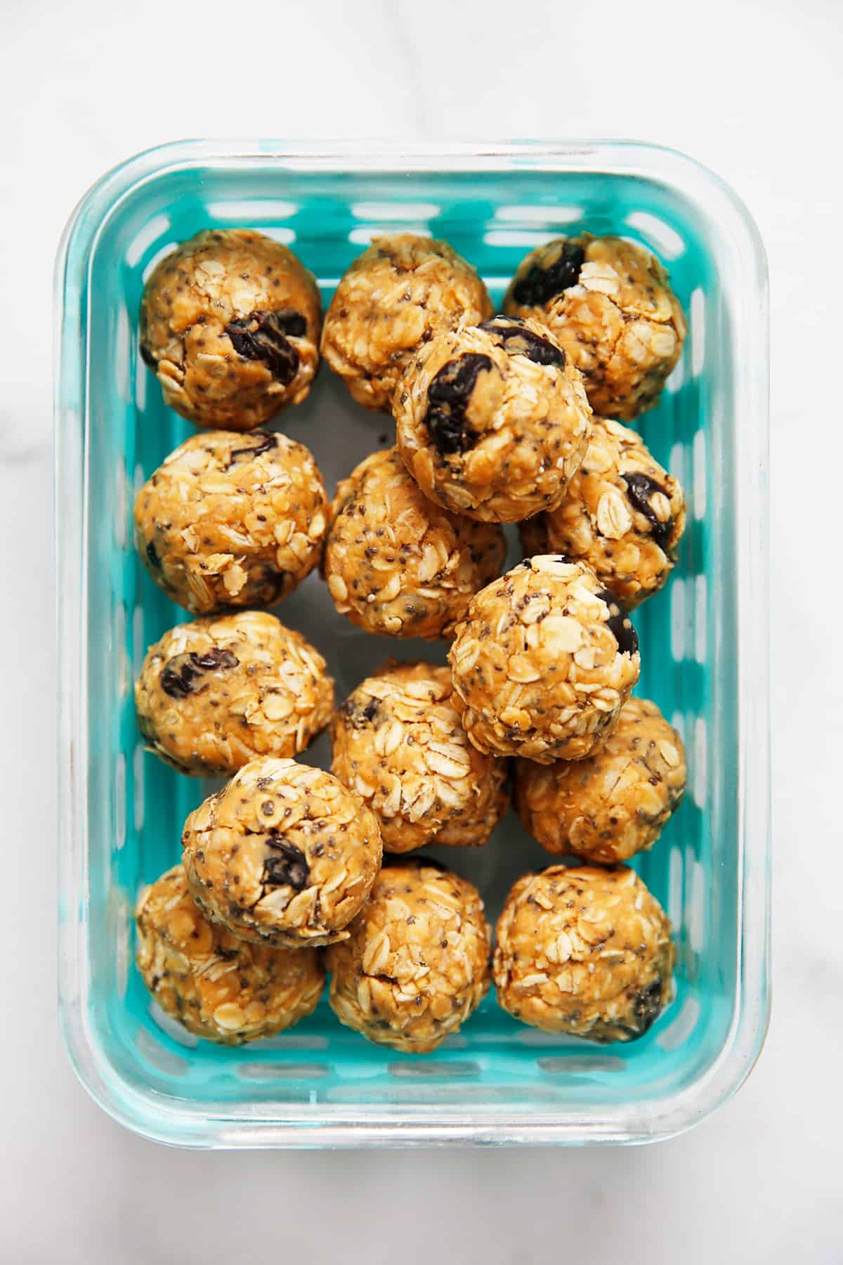 Peanut butter oatmeal energy bites in a glass container