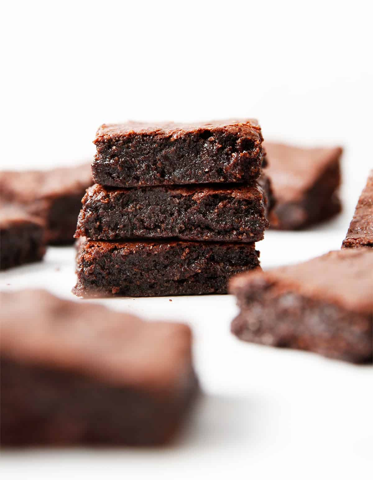 Super fudgy paleo brownies stacked up