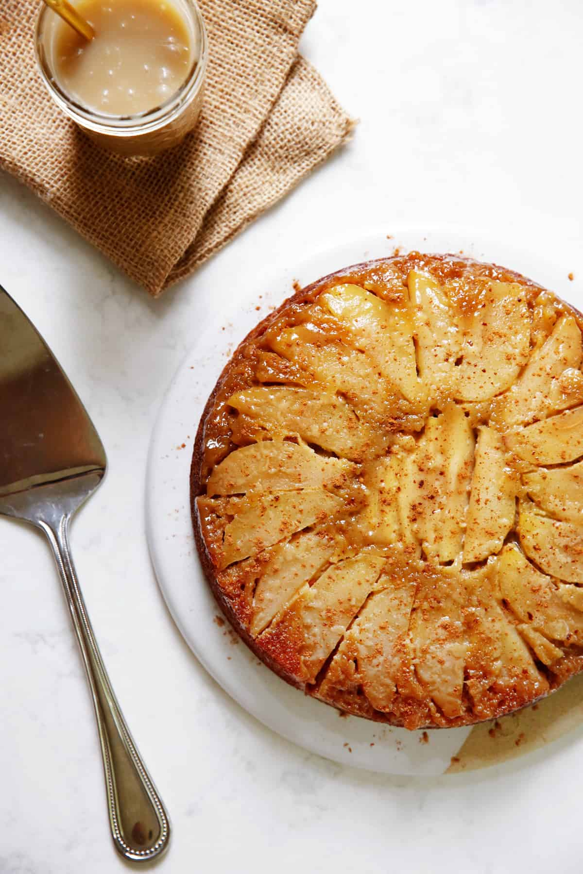 upside down apple honey cake with caramel on a platter