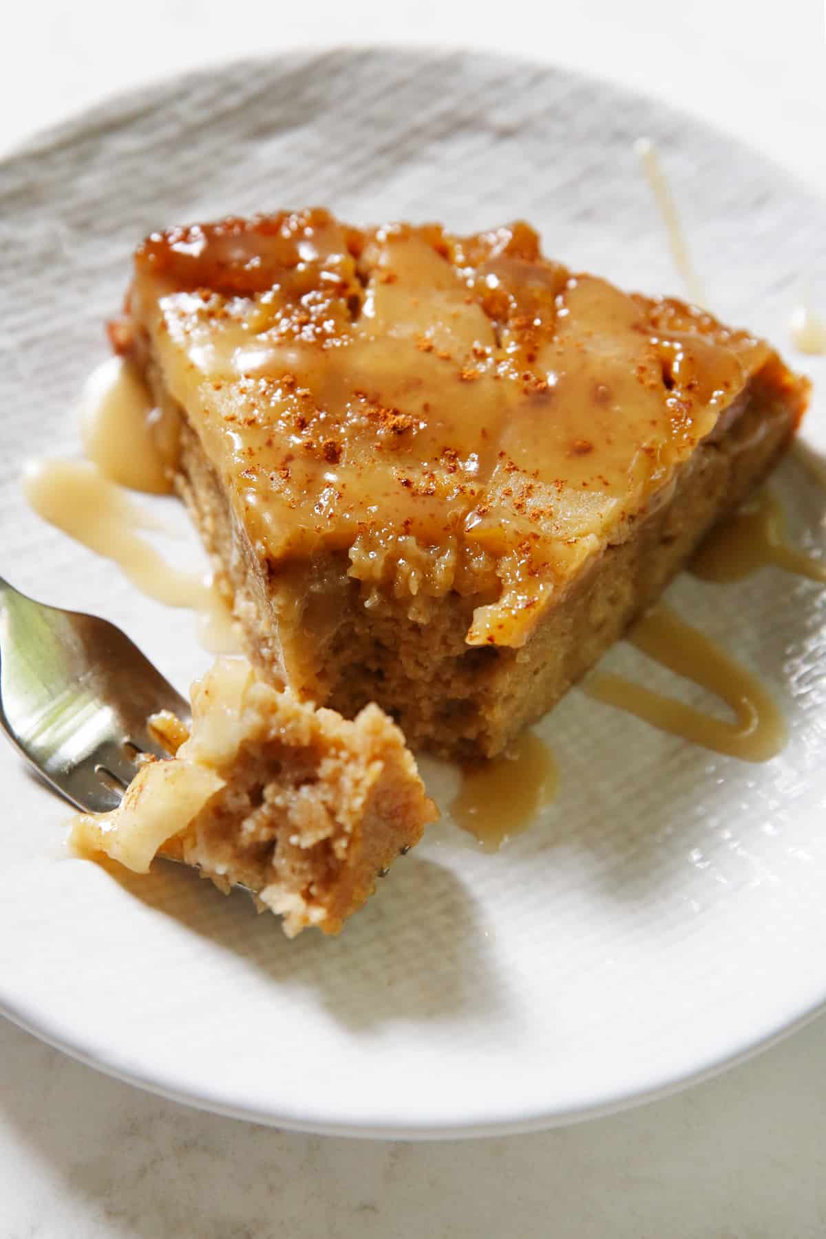Slice of gluten free apple cake on a plate