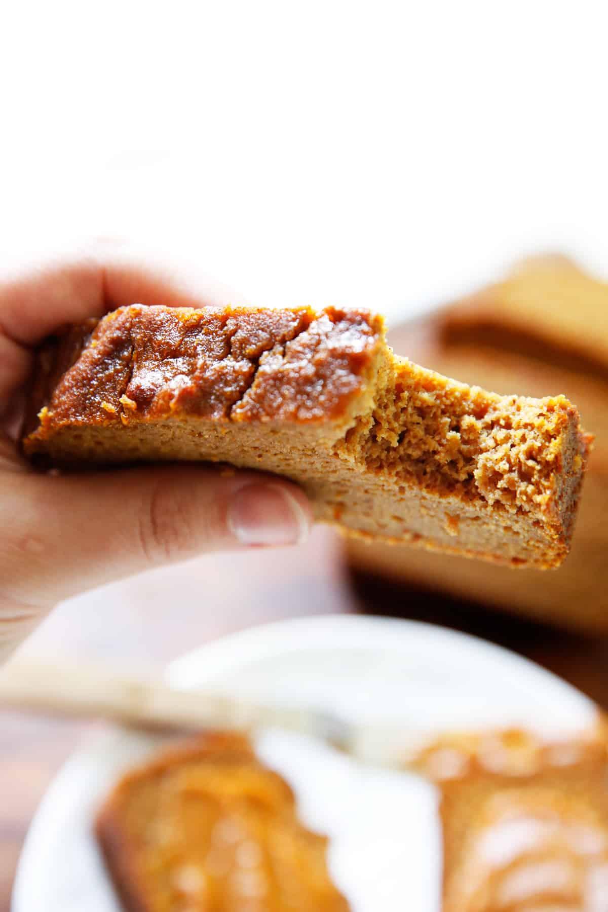 A bite taken out of gluten free pumpkin bread