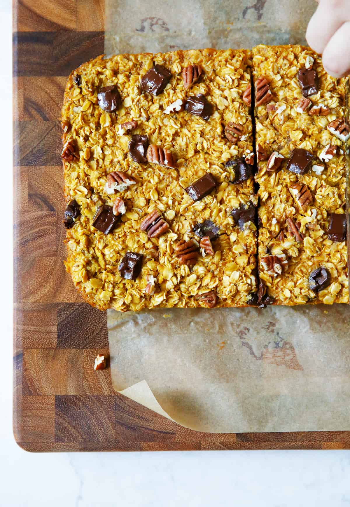 cutting squares of pumpkin baked oatmeal