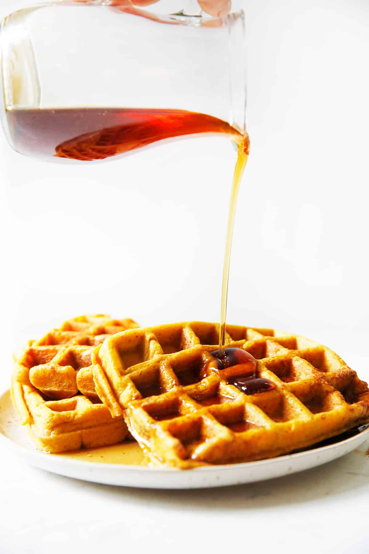 gluten free pumpkin waffles with maple syrup