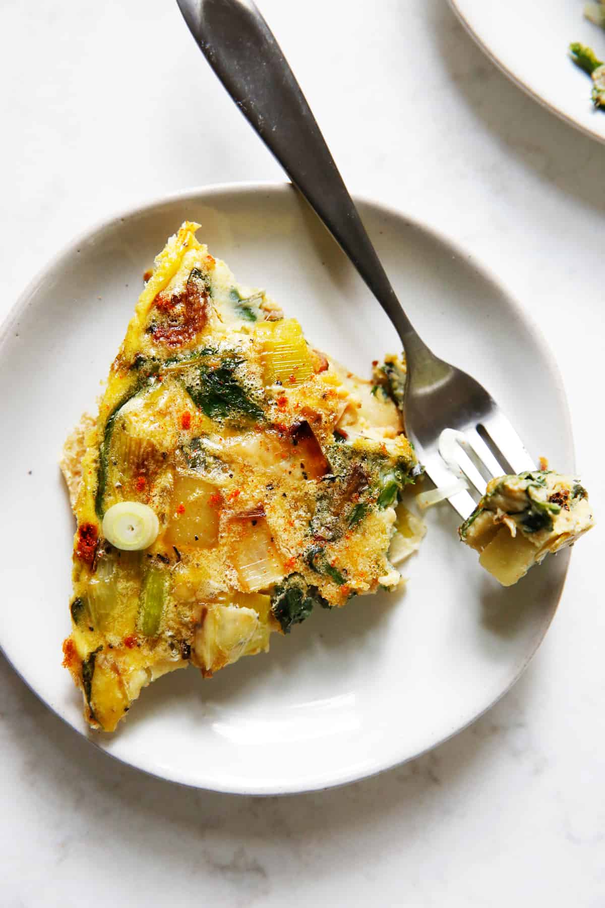 Frittata with leeks, potatoes and Swiss chard on a plate.