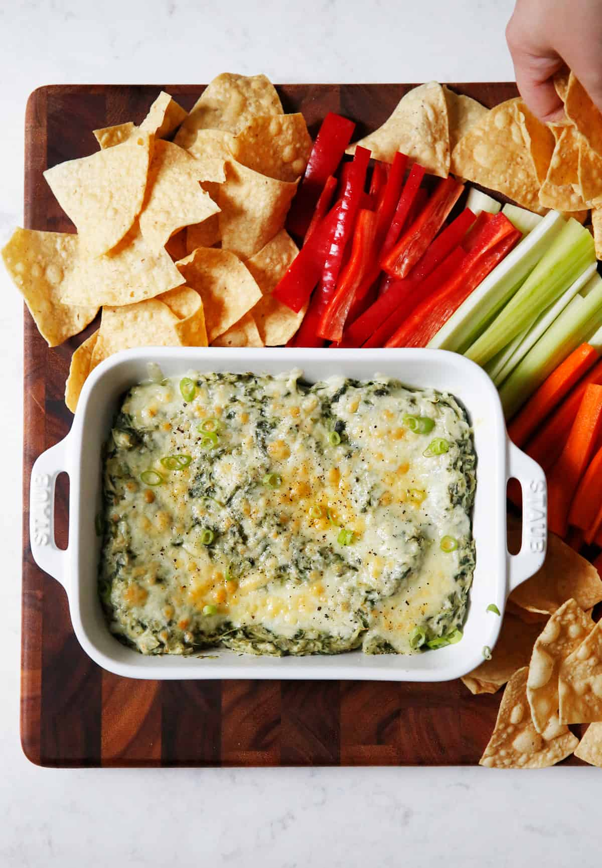 Healthy spinach dip with chips and veggies.