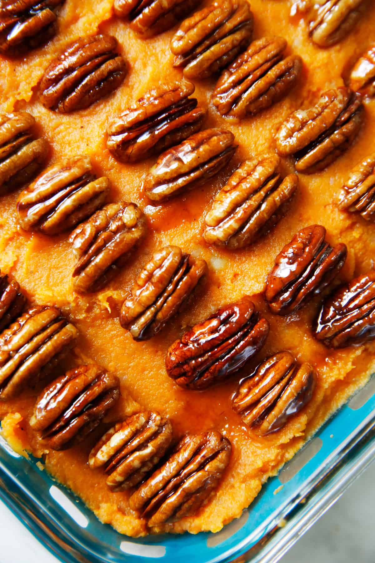 Healthy sweet potato casserole with candied pecans on top