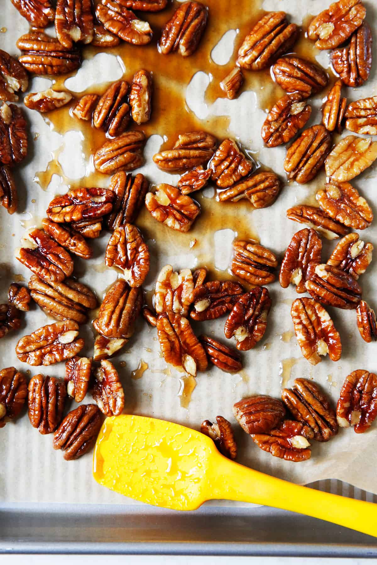 Candied pecans on a sheet pan