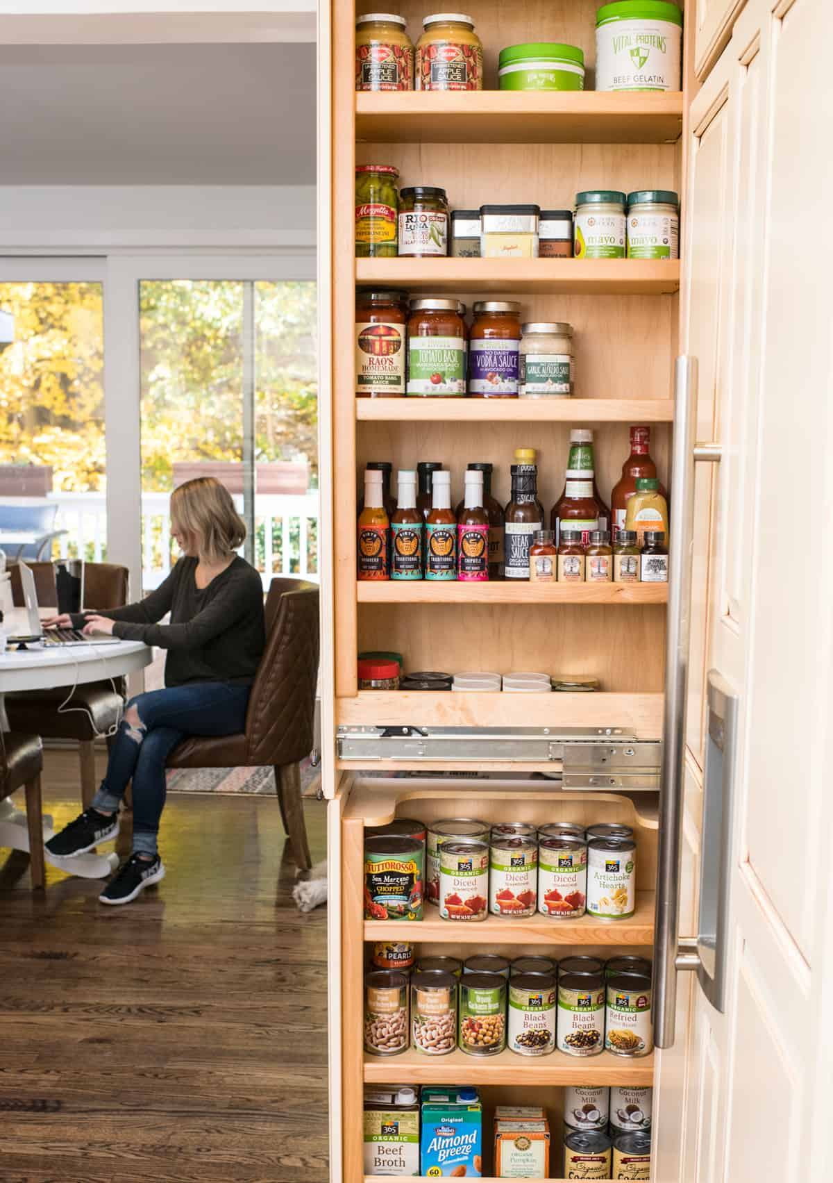 A well stocked pantry with the doors open.