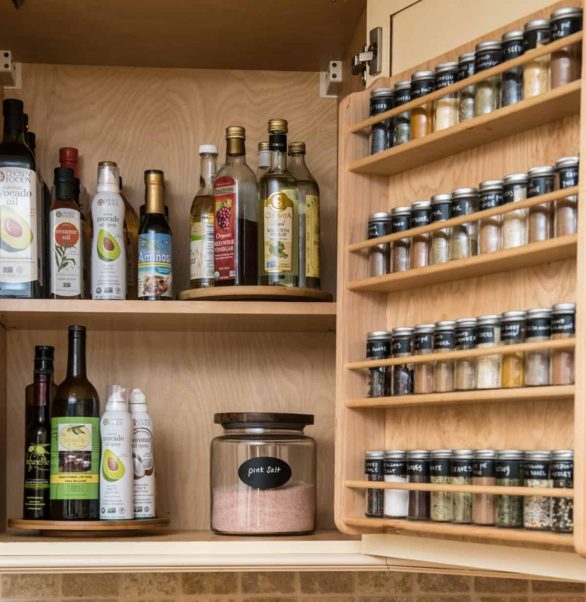 salt, spices, oils in cabinet