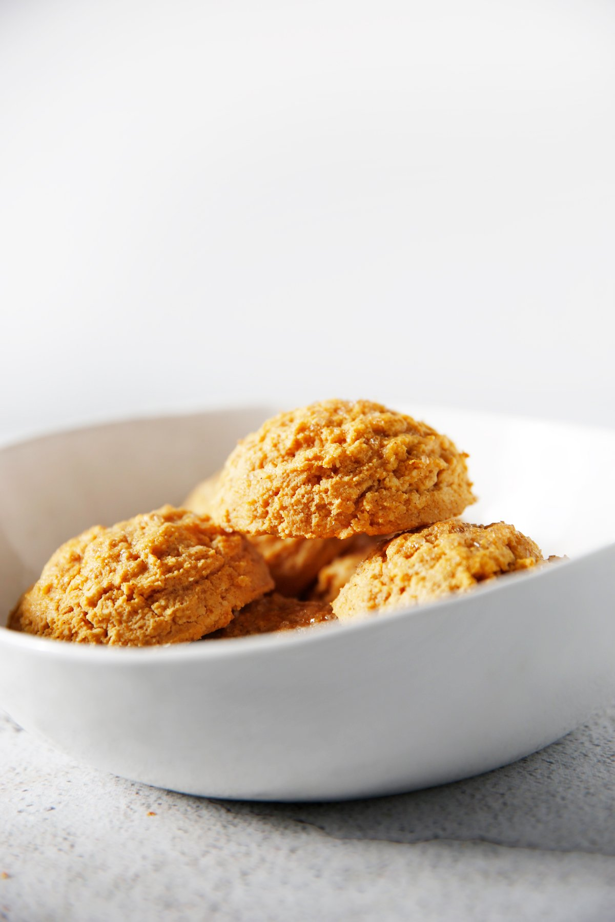 Gluten free pumpkin biscuits in a bowl.