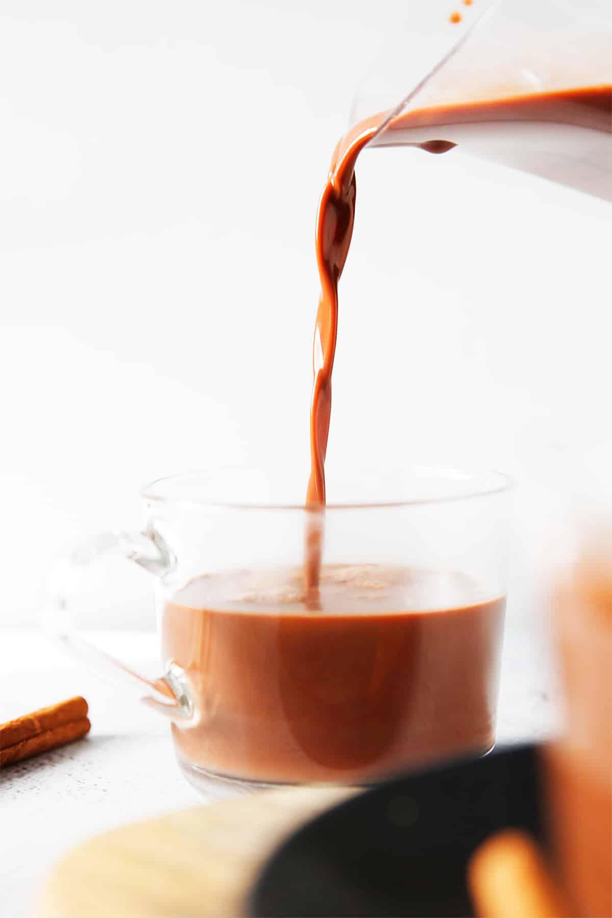 pouring vegan hot chocolate in a mug