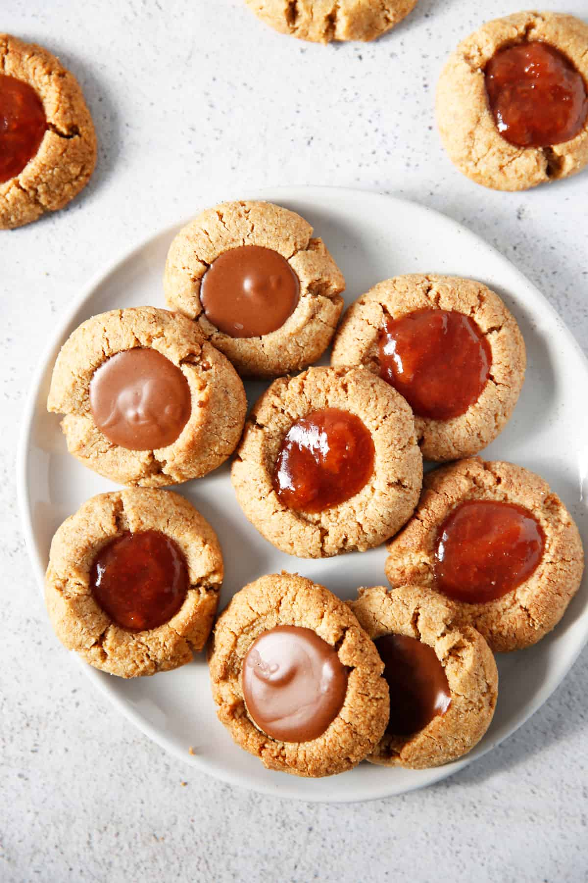 Gluten free thumbprint cookies on a plate.