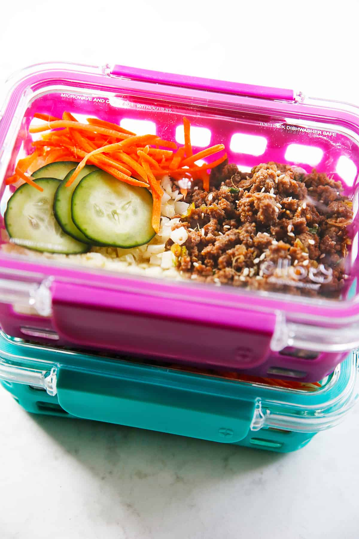 Korean ground beef bowls in meal prep containers.