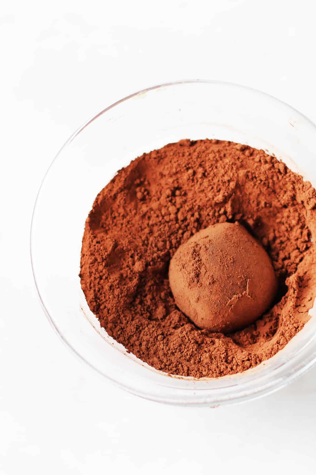 Chocolate truffle in cocoa powder.