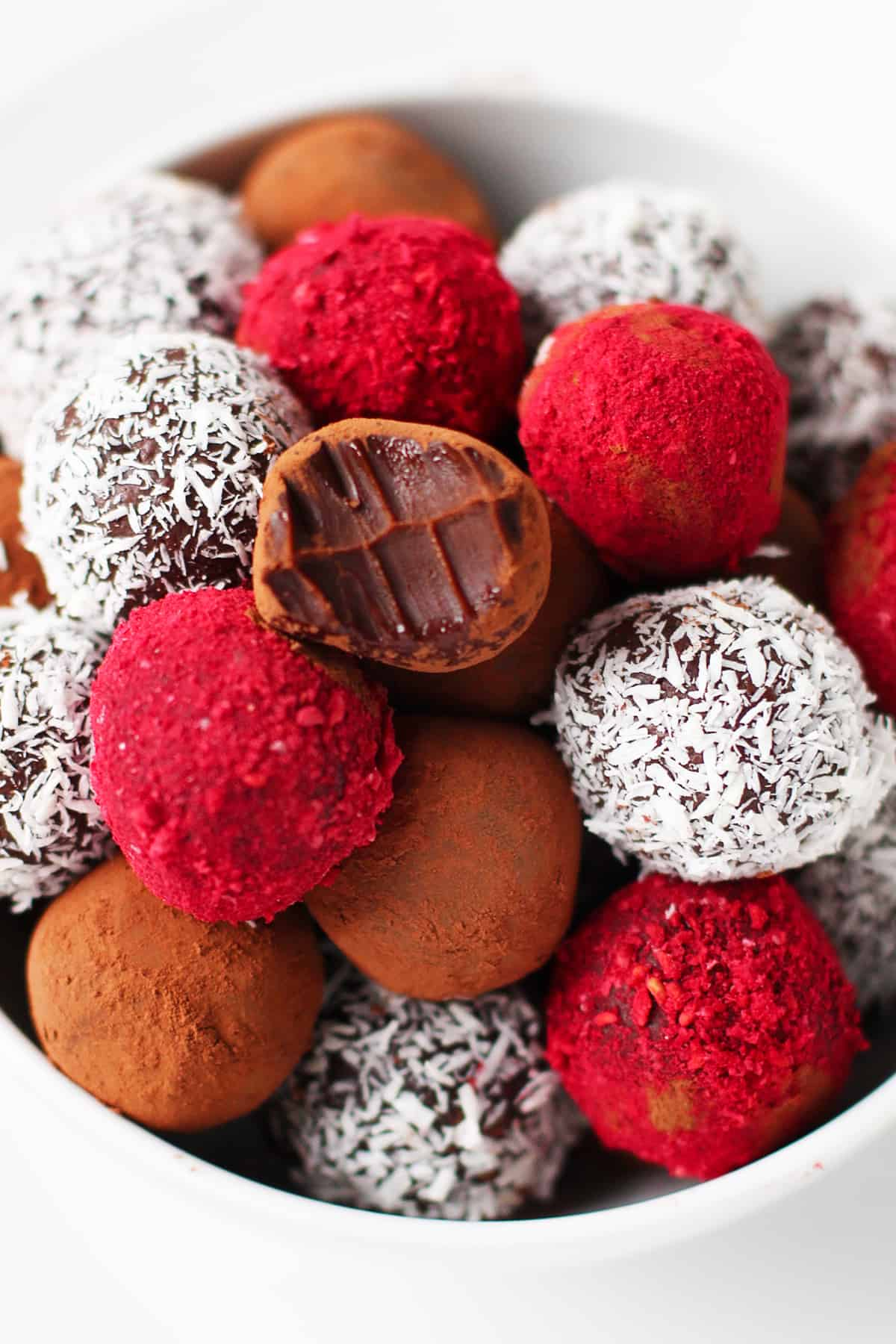 Bowl of different flavors of chocolate truffles.