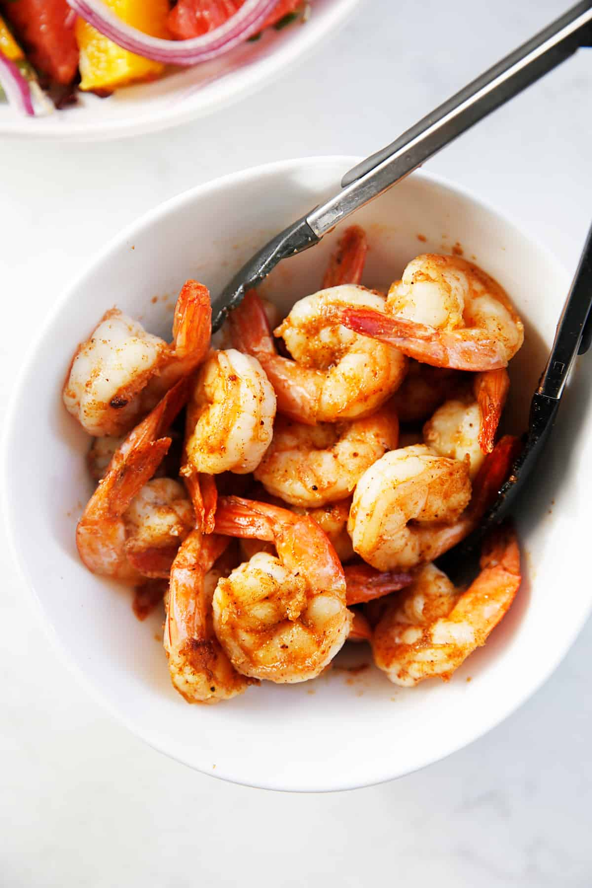 Cooked spicy shrimp for the salad in a bowl.
