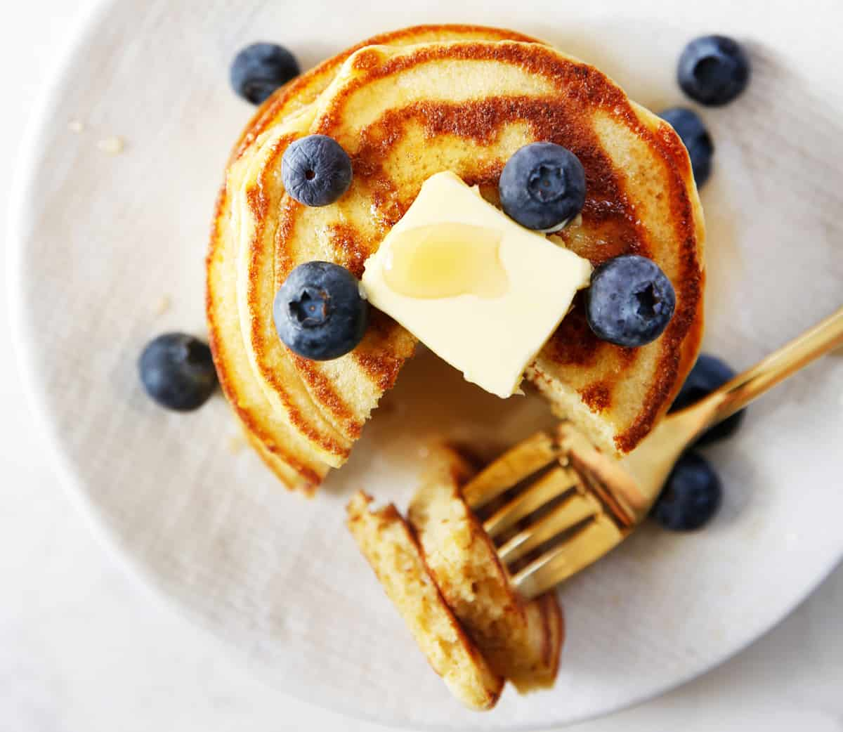 Paleo Pancakes with blueberries and butter.