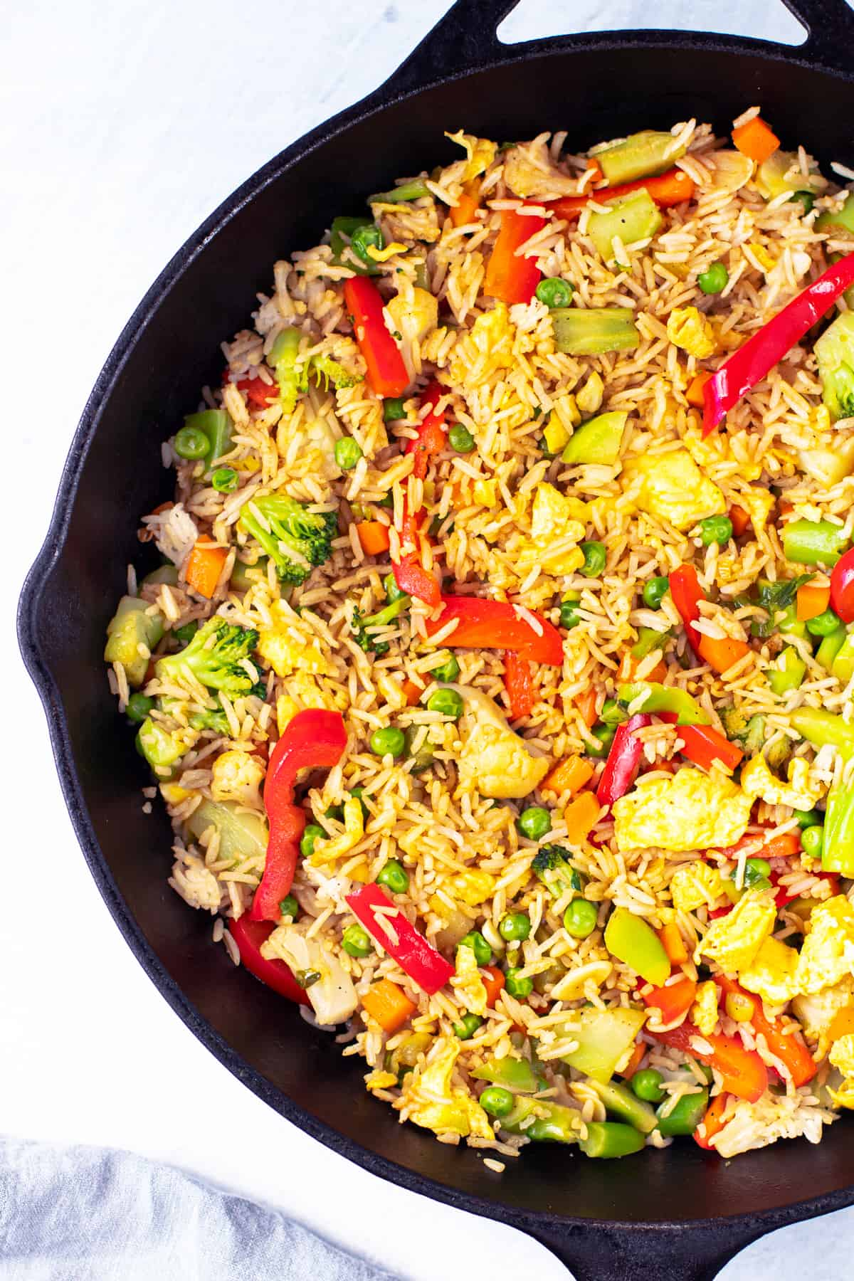 A skillet with veggie fried rice.