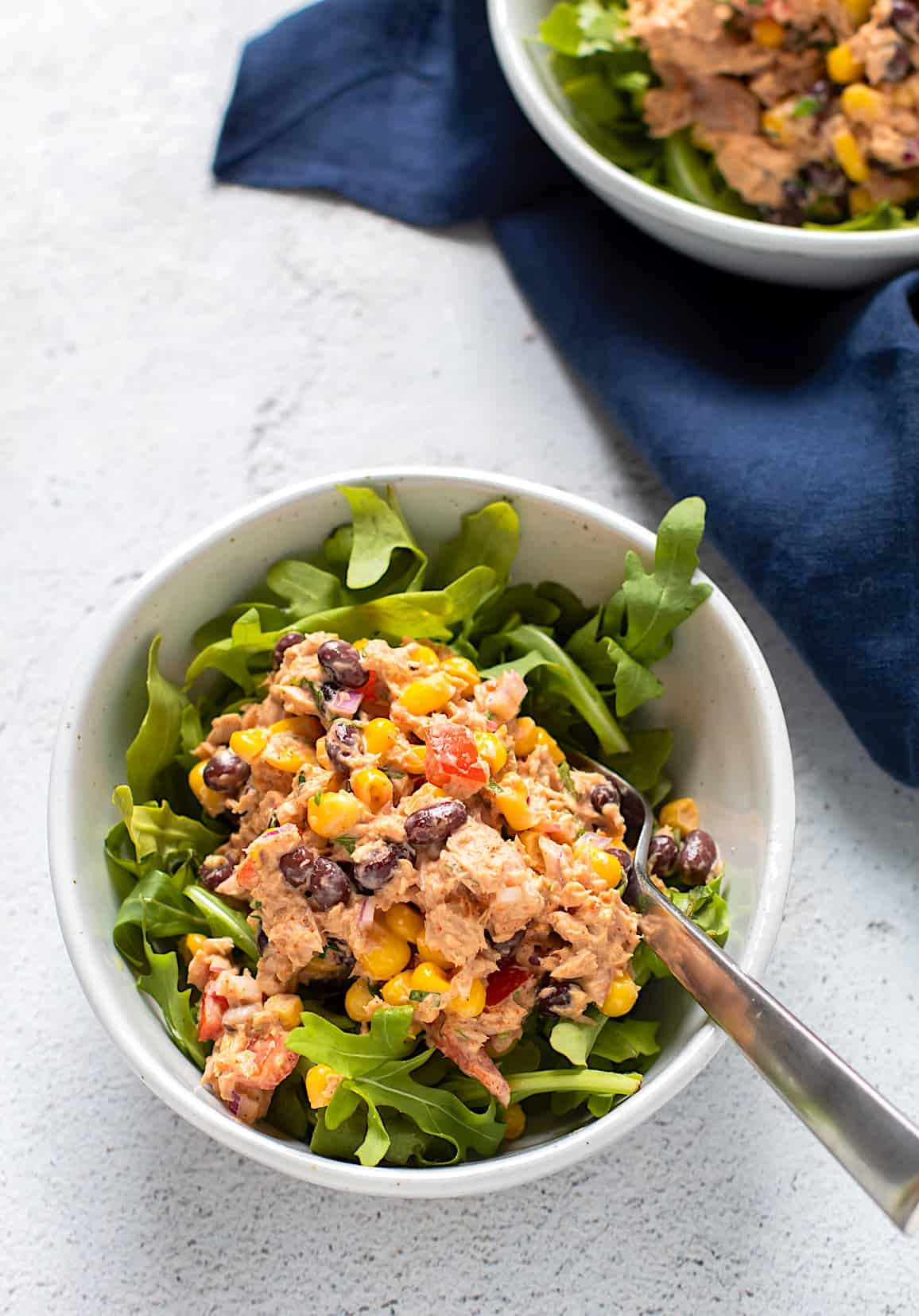 A bowl of southwest tuna salad with lettuce.