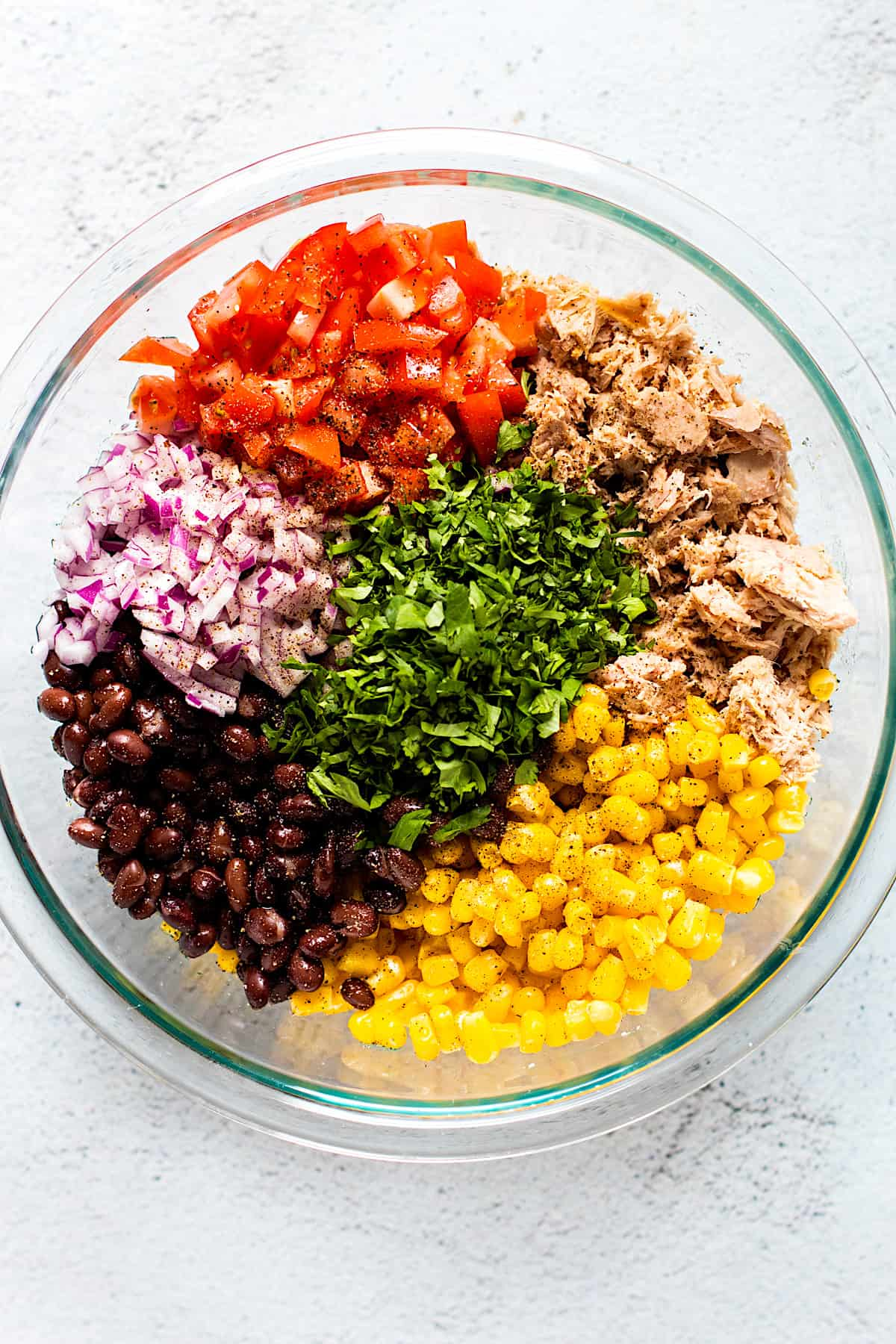 Ingredients for tuna salad in a bowl.