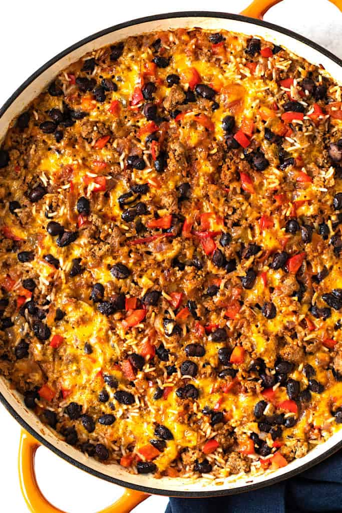 Baked taco casserole in a skillet.