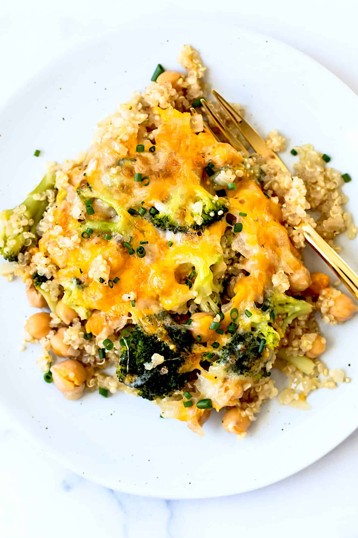 Quinoa casserole with broccoli and cheese on a plate.
