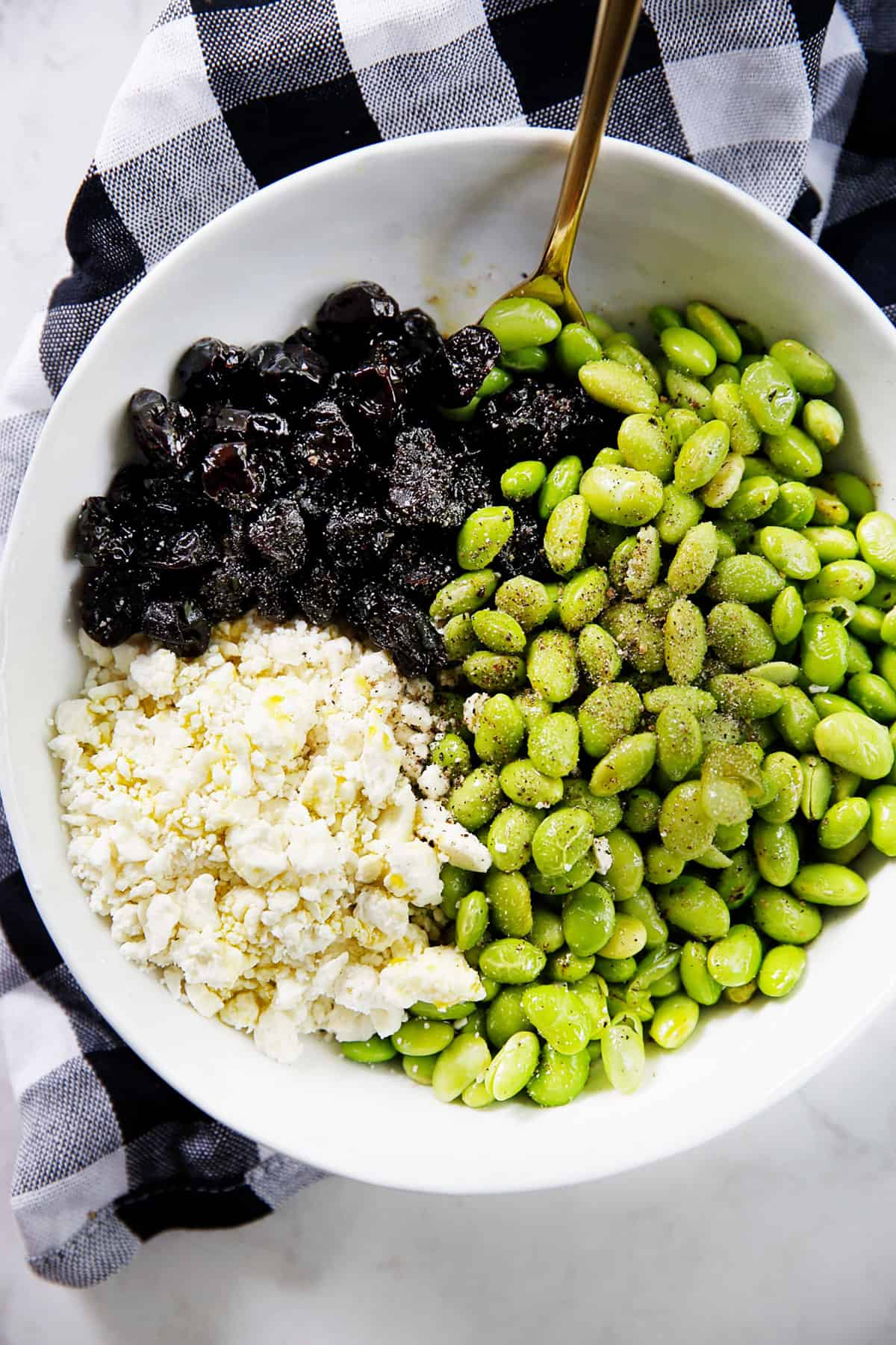 Ingredients for easy edamame salad with cherries and feta.
