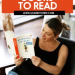 Lexi reading a pregnancy book in chair