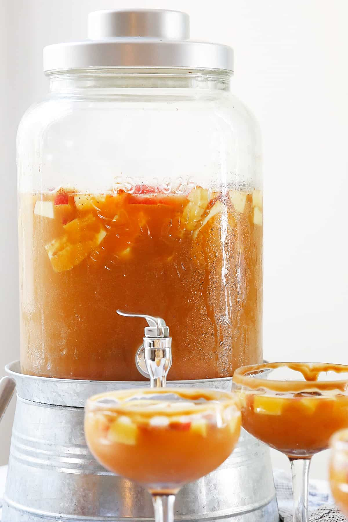A large container of apple cider sangria.