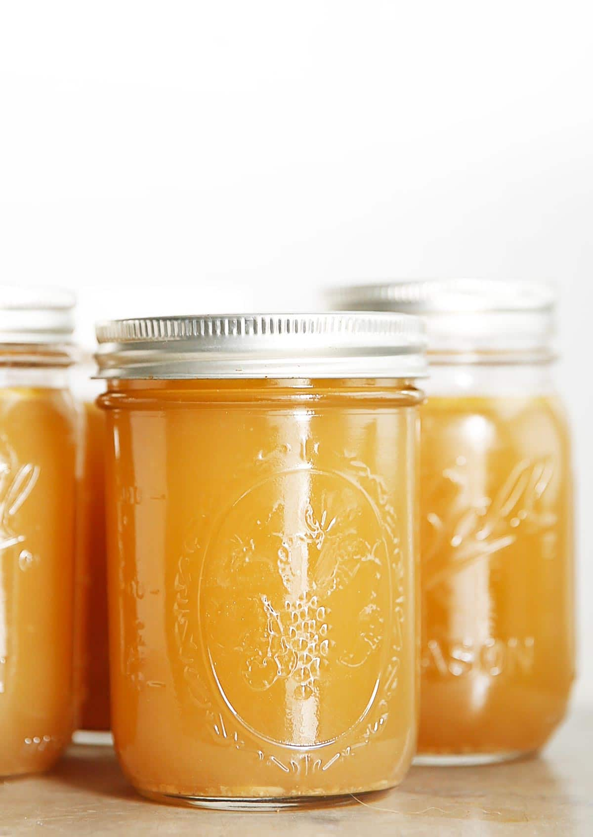 Homemade chicken stock in jars.