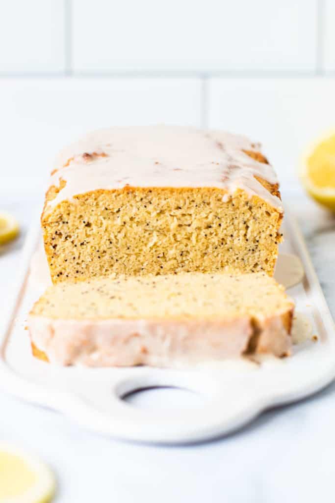 Gluten free lemon poppy seed bread with a slice taken out of it.