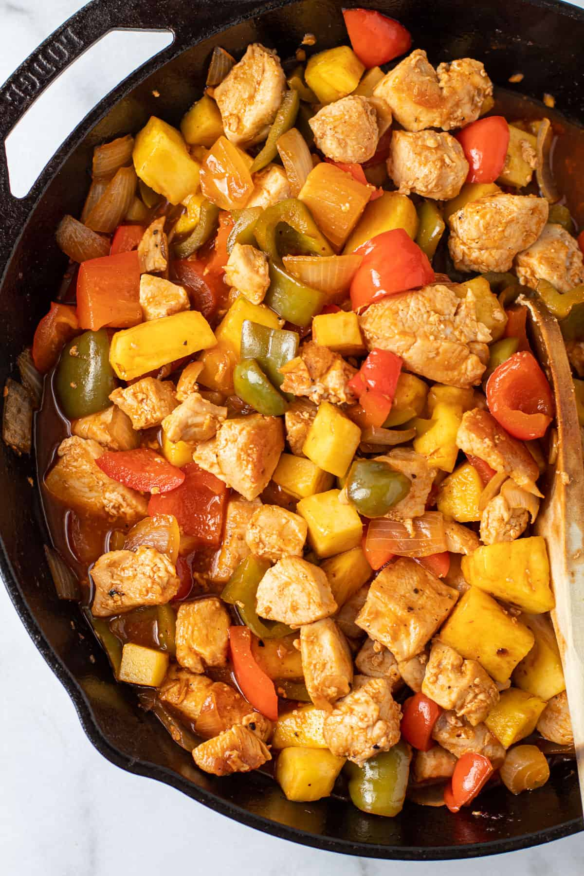 Pineapple chicken in a skillet.
