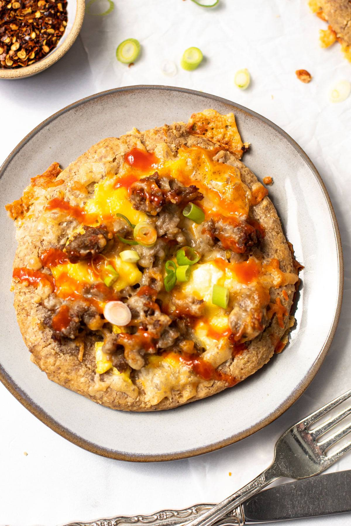 Breakfast pizza on a plate.