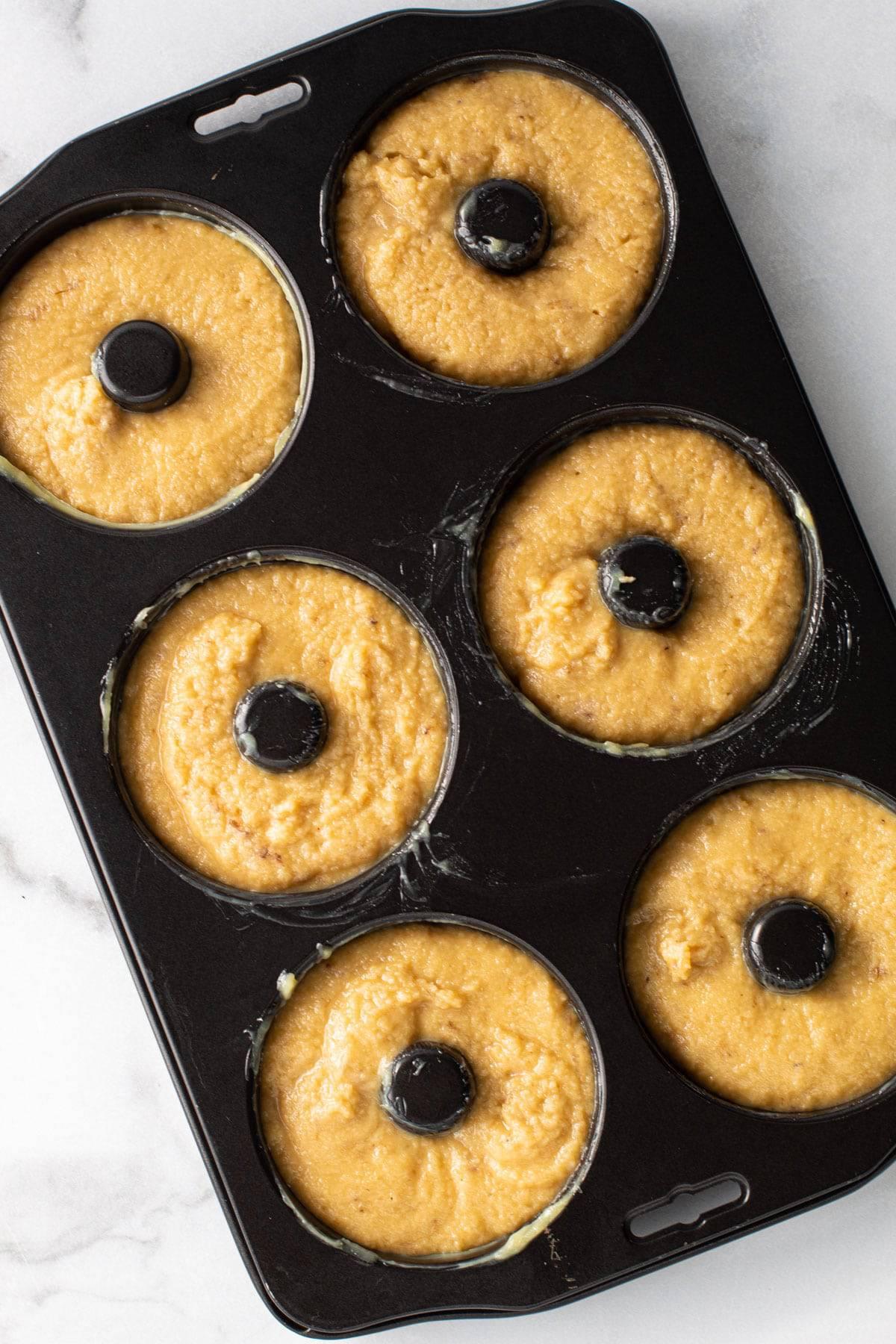 Gluten Free Banana Doughnuts in a baking tray.