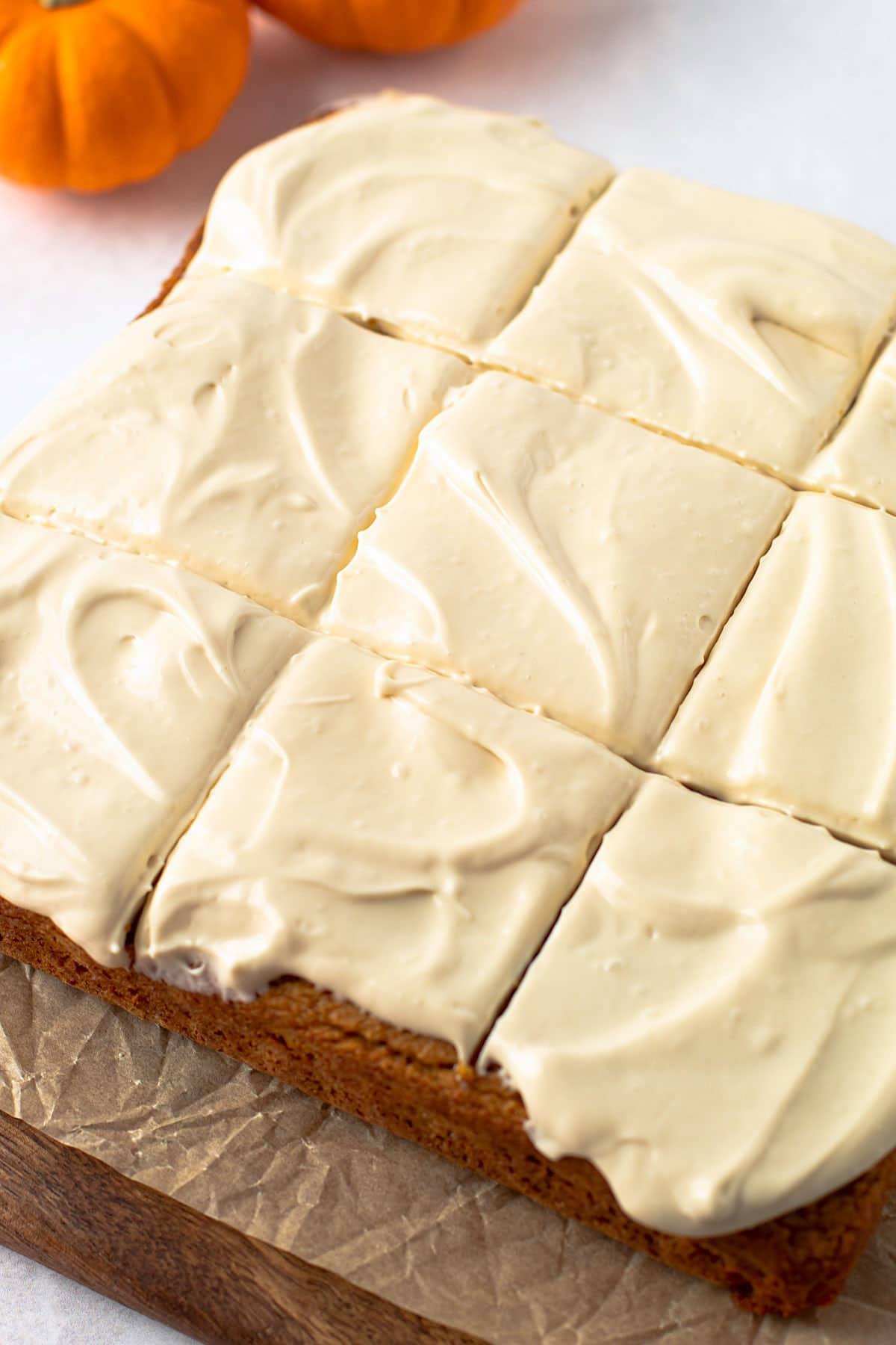 Sliced gluten free pumpkin cake with cream cheese frosting.