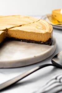 A slice of vegan pumpkin cheesecake.