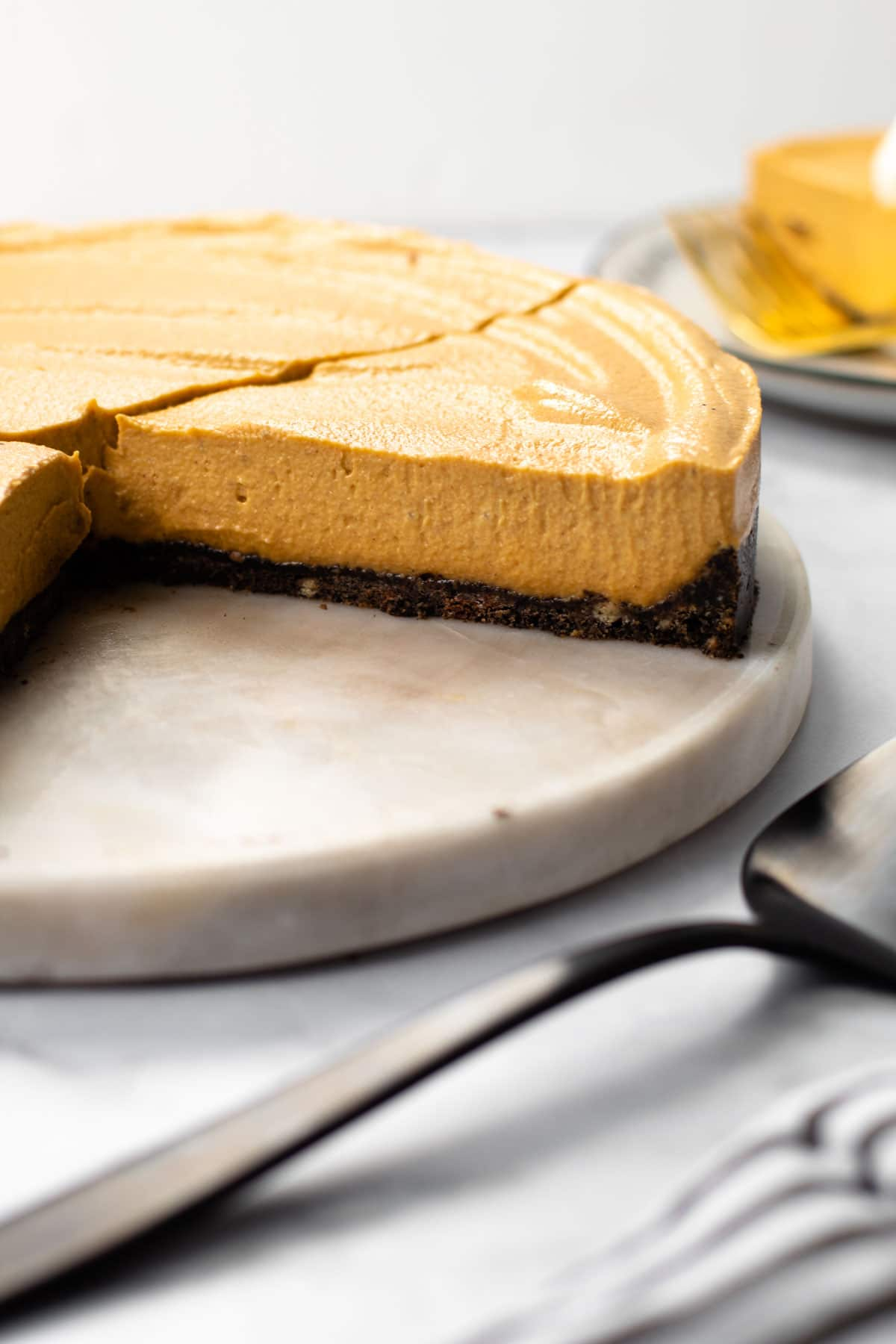 A slice of vegan pumpkin cheesecake.