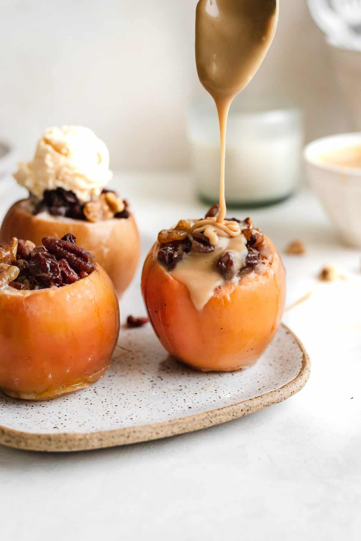 A plate of baked apples with caramel.