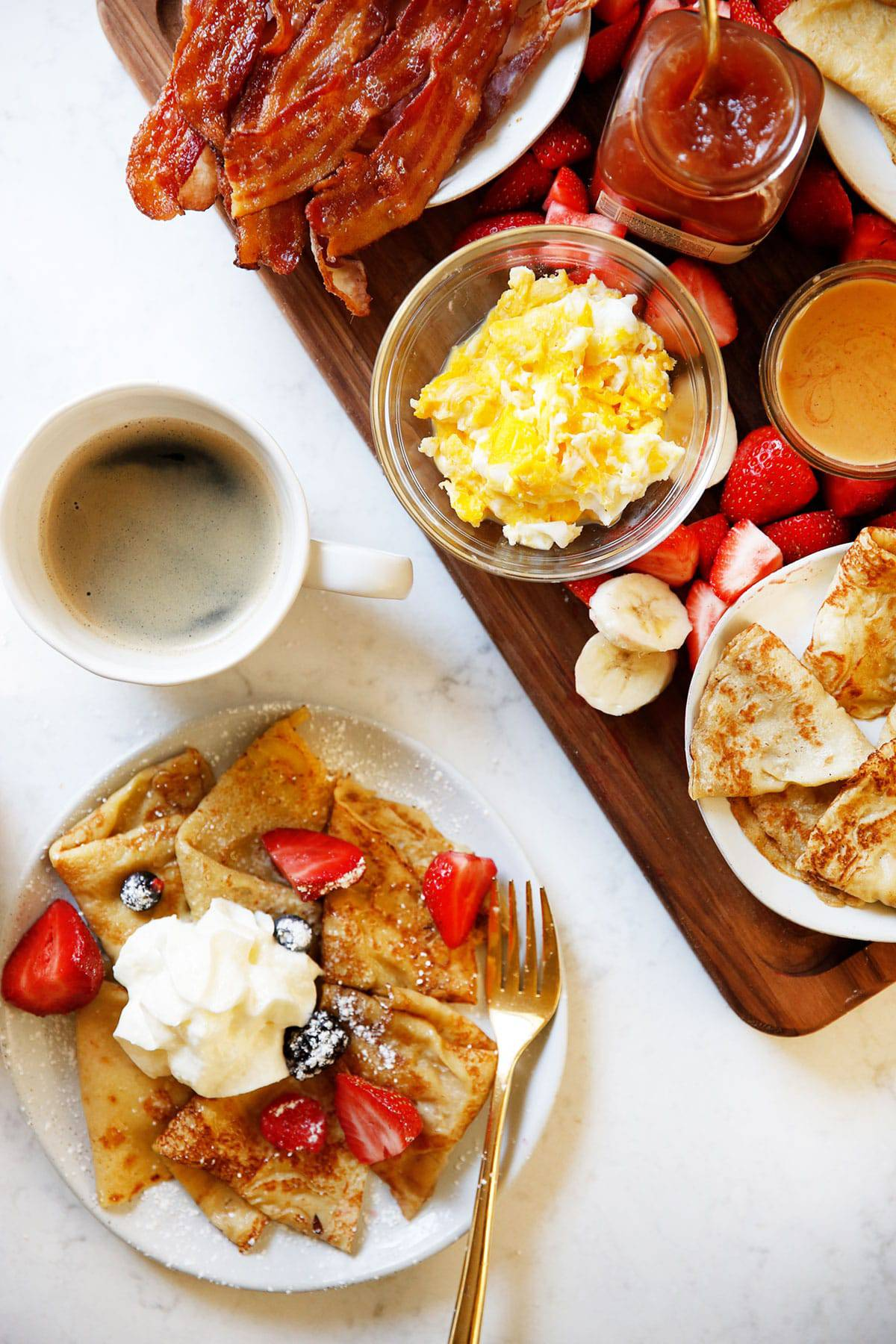 A breakfast spread with gluten-free crepes and coffee.