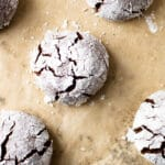 Gluten-free chocolate crinkle cookies on a baking sheet.