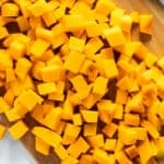 Diced butternut squash on a cutting board
