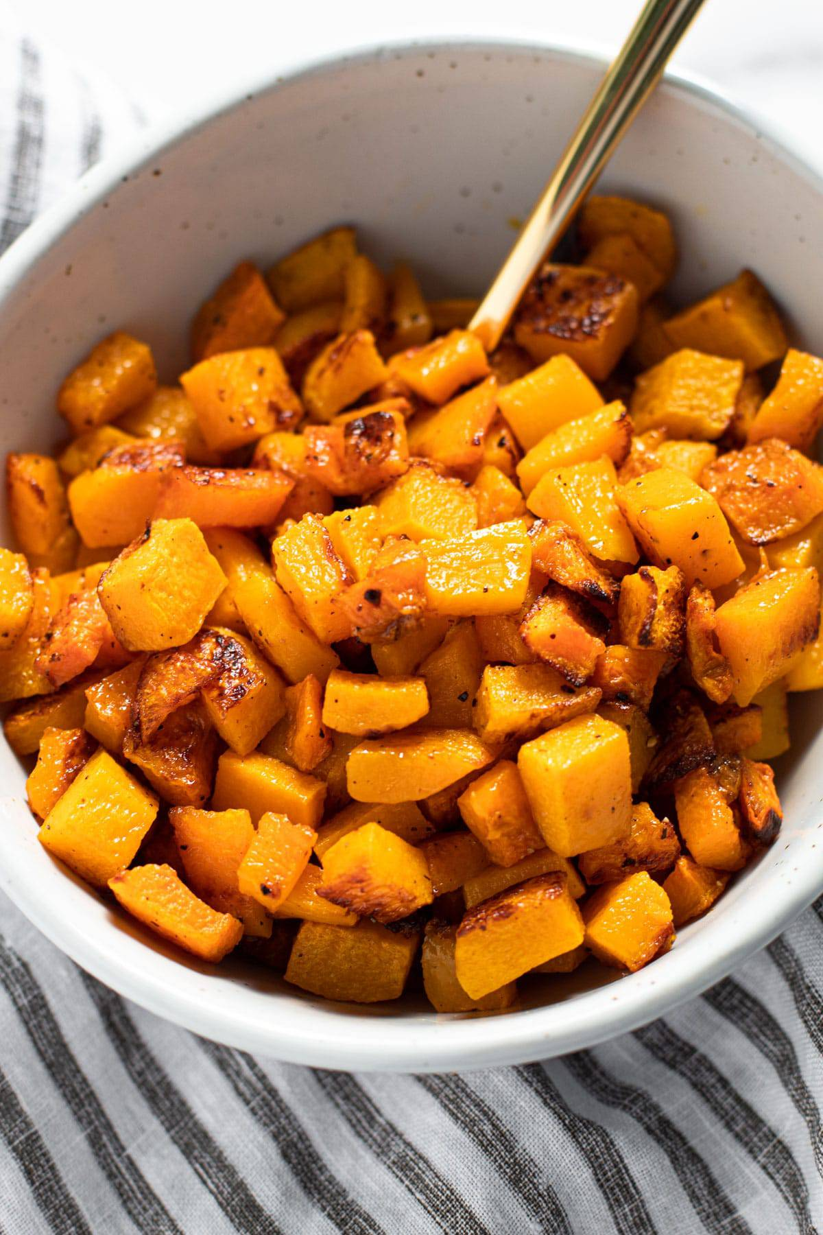 A bowl of roasted butternut squash.