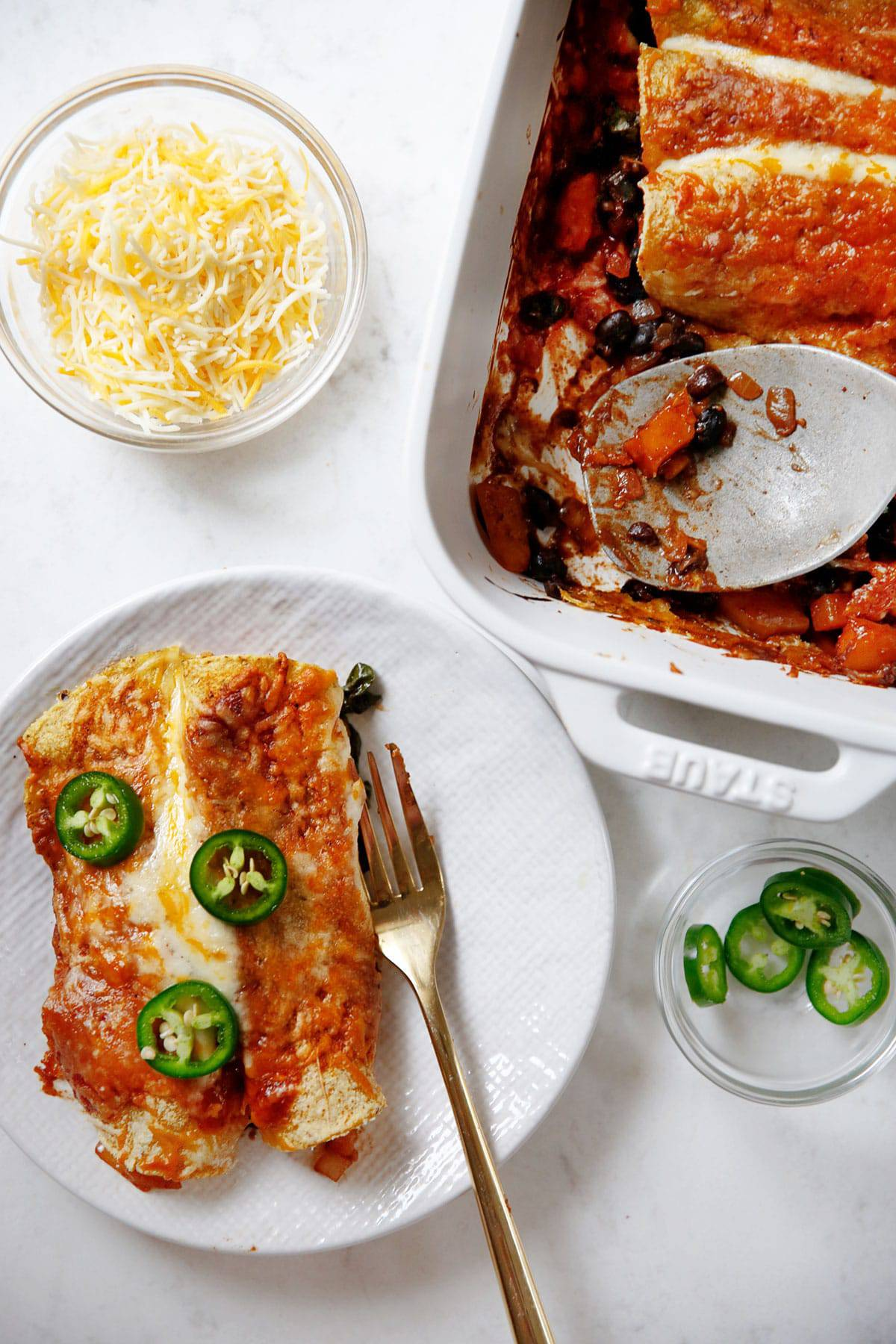 Baked and plated butternut squash and bean enchiladas.
