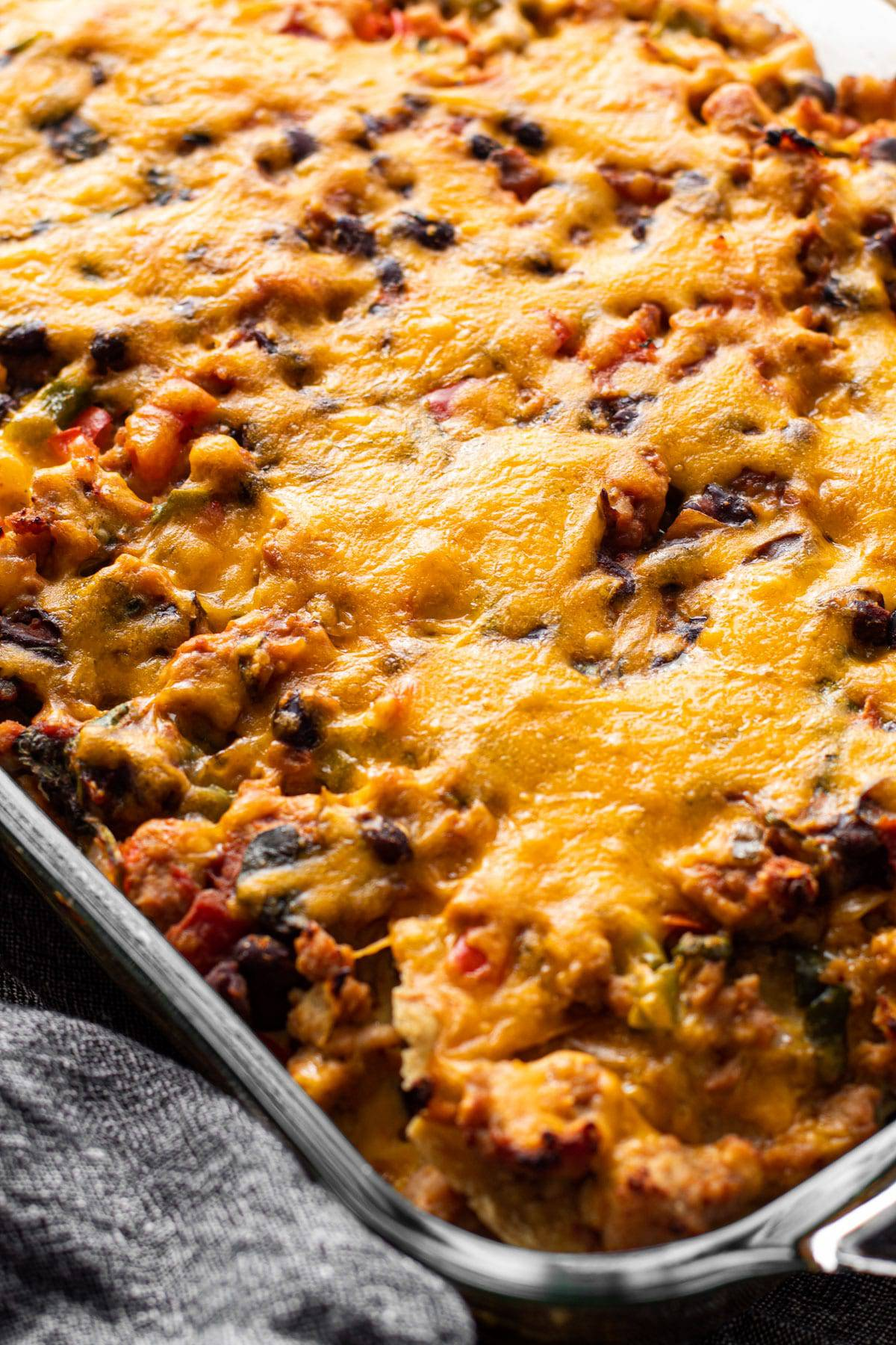 A cheesy top on a baked Mexican breakfast casserole.