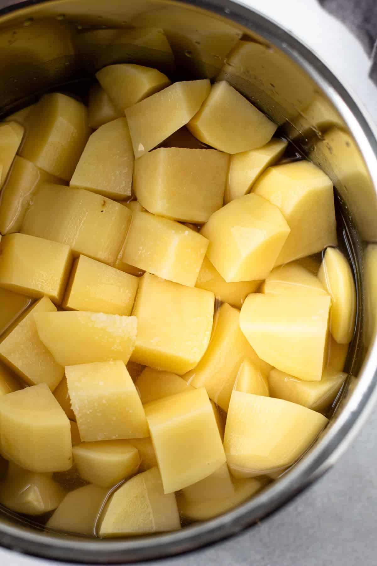 Cubed and raw potatoes in an instant pot.