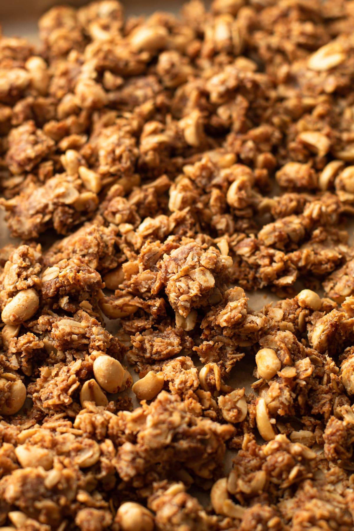 Baked peanut butter granola on a baking sheet.