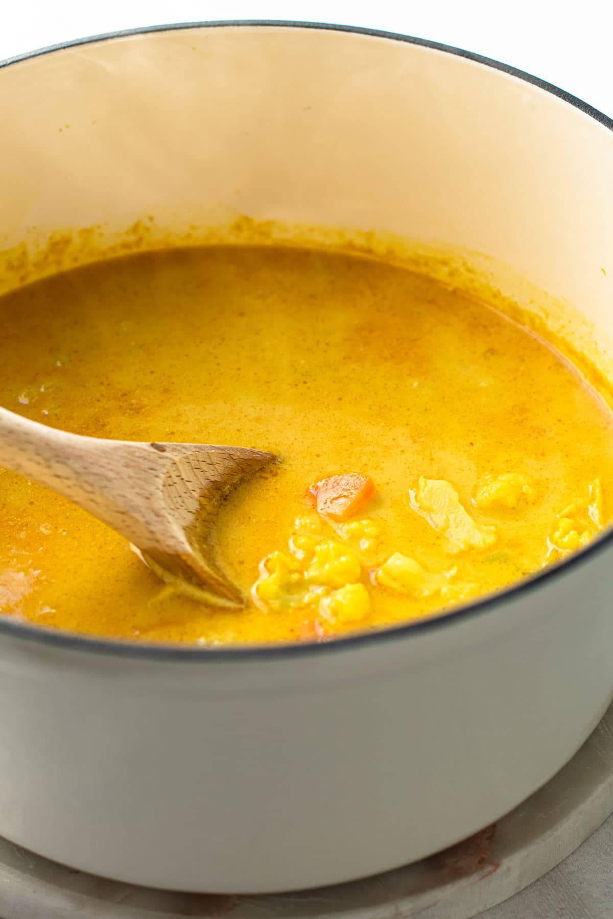 A pot of vegan cauliflower soup.